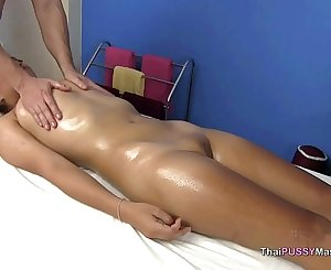 Little Asian lady receives oil massage