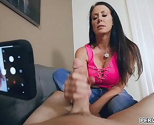 Milf Reagan proves she's a cool mom to stepson Ike who later on got his cock a nice handjob