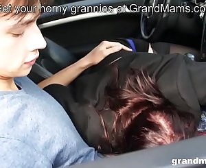 Horny rich granny manhandles young sausage after a long drive